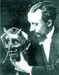 Melies holding a devil mask